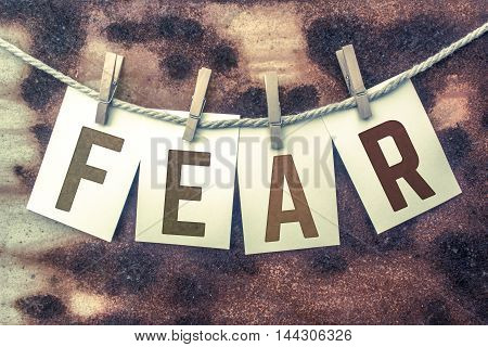 Fear Concept Pinned Stamped Cards On Twine Theme