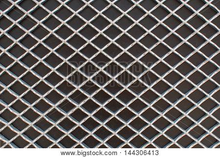 Rhombus Metal Pattern On Black Surface