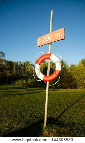 A ring life buoy on a pole.
