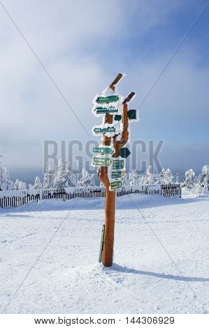 snow-covered and frost-covered signposts on the Fichtelberg in the Ore Mountains in Saxony, Germany    Germany