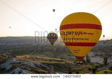 GOREME TURKEY - JUNE 23 2015: The great tourist attraction of Cappadocia - balloon flight. Cappadocia is known around the world as one of the best places to fly with hot air balloons. Goreme Turkey