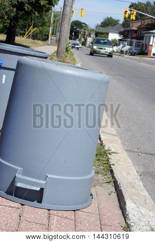 A closeup view of some garbage cans for the weekly trash pickup.