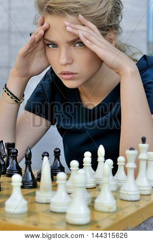 Blonde Thought While Playing Chess.