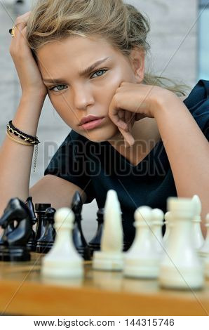 Girl Playing Chess.