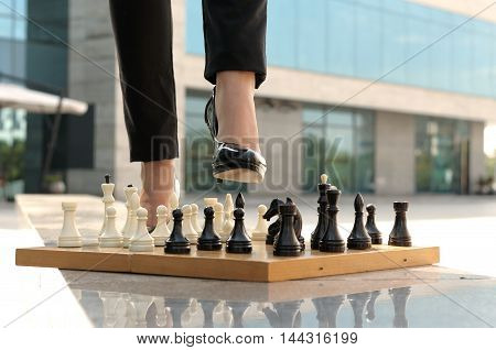 Female Feet Stepping On A Chess