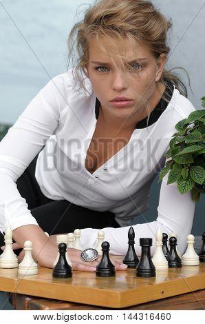 Fashion Model Posing Near The Chess Board