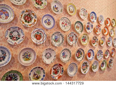 Old colorful plates mounted on the wall
