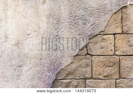 Background with broke off a brick wall mastic