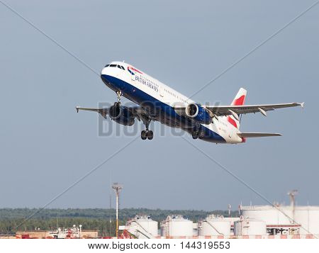 Moscow - July 31 2016: beautiful passenger aircraft Airbus A321-231 British Airways flies to Domodedovo airport and on a background of blue sky July 31 2016 Moscow Russia
