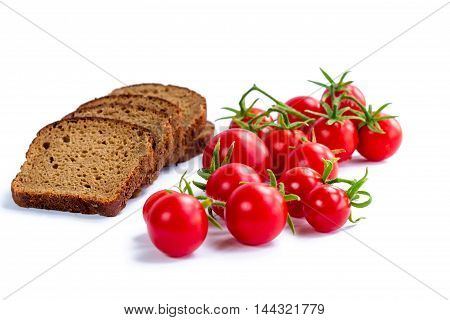 Composition of black bread and bunch of cherry tomatoes