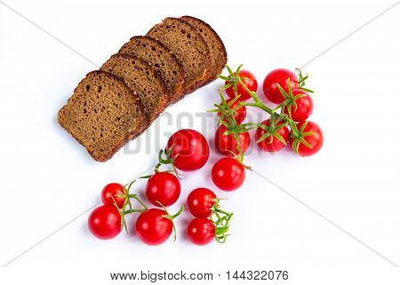 Composition of black bread and bunch of tomatoes