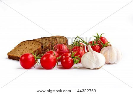 Set of black bread slices bunch of cherry tomatoes garlic