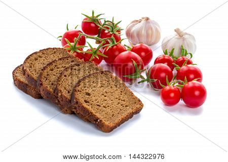 Composition of black bread slices cherry tomatoes and garlic