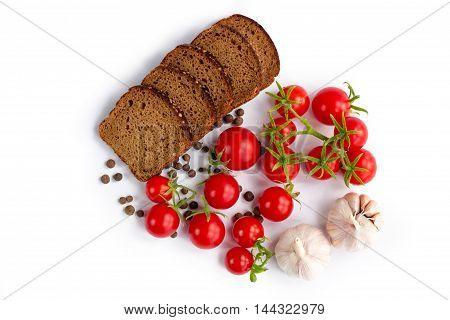 Set of black bread tomatoes and garlic