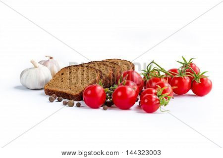 Composition of bread slices cherry tomatoes and garlic