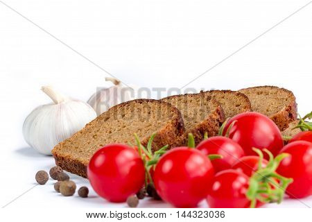 Set of bread bunch of cherry tomatoes and garlic