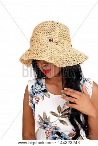 A mystery woman with a beige straw hat and long black hair looking down with one hand on chest isolated for white background.