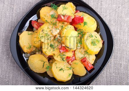 Top View On A Stew Of Potatoes With Onion And Bell Pepper