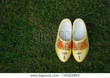 Traditional Dutch wooden clog shoes on grass