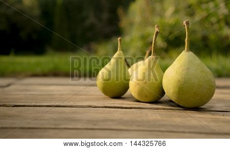 Fresh ripe pears on natural background. close-up