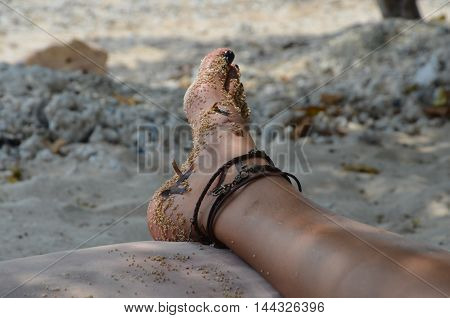 A woman relaxes on the beach during holidays