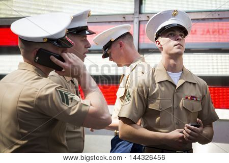 NEW YORK - MAY 26 2016: U.S. Navy Sailors and Marines gather at the Armed Forces Recruiting Station on Military Island Pedestrian Plaza in Times Square during Fleet Week NY 2016.