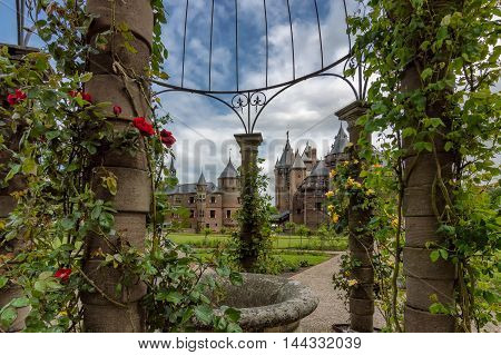 Garden of the De Haar Castle with flowers in the foreground