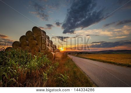 Sunset and the pyramid of straw bales. Moravian landscape Boskovice.
