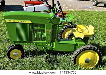 YANKTON, SOUTH DAKOTA, August 20, 2016: The John Deere pedal tractor is displayed at the Yankton, South Dakota Riverboat Days held annually the 3rd weekend of August.
