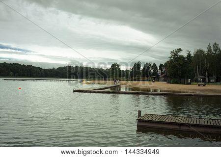 sandy beach near the pond, summer, stormy sky