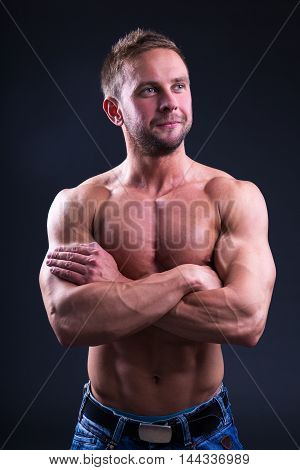 Happy Young Muscular Man Over Dark Background