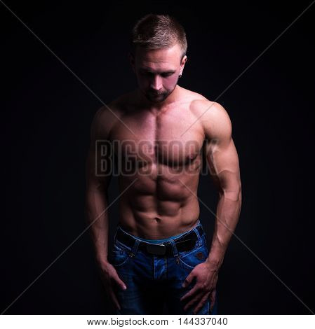 Sport Concept - Handsome Muscular Man Posing Over Dark Background