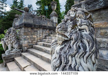 Lion statues in gardens of Peles Castle near Sinaia city in Romania
