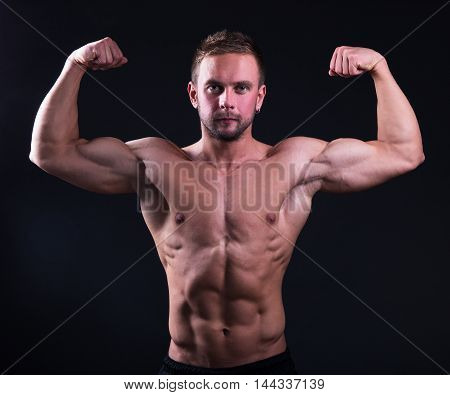 Portrait Of Handsome Muscular Man Showing His Muscles Over Grey