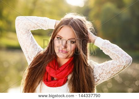 Fall lifestyle concept harmony freedom. Beauty young woman fashion girl relaxing walking in autumnal park outdoor