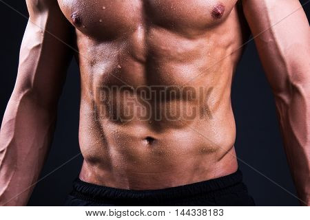 Close Up Of Muscular Male Body Over Grey