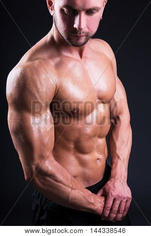 Portrait Of Sexy Young Muscular Man Standing Over Grey