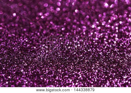 Glamour pink sparkling background. Blured glitter background with blinking stars. Holiday abstract texture.