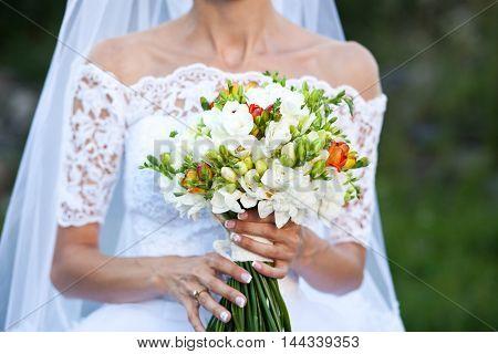 Bride holding white wedding bouquet