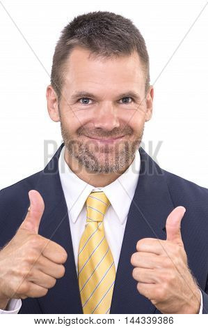 Closeup portrait of handsome and successful businessman smiling and giving two thumbs up on white background