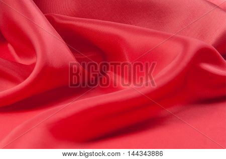 Red silk fabric tecture. for Drapery Abstract Background. Smooth elegant red silk.