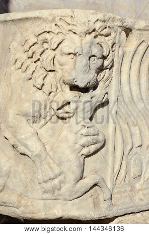 Relief of lion kills an antelope from an ancient roman sarcophagus replica in Villa Borghese public park Rome