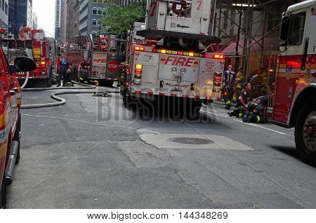 NEW YORK, NEW YORK- AUGUST 20 : New York City Fire Department on scene August 20th 2016 at East 40th Street between Park Avenue and Madison Avenue, NYC.