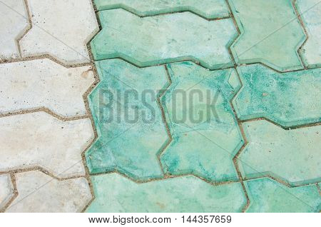 tile texture stones Square. Stone paving texture. Abstract structured background. Brick pavement. Brick worm on the walkway