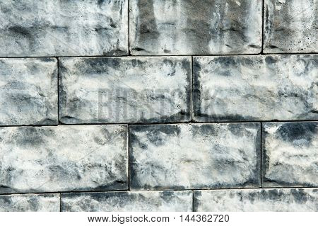 Texture, Background. Decorative Brick, Building Decoration. A Small Rectangular Block Typically Made