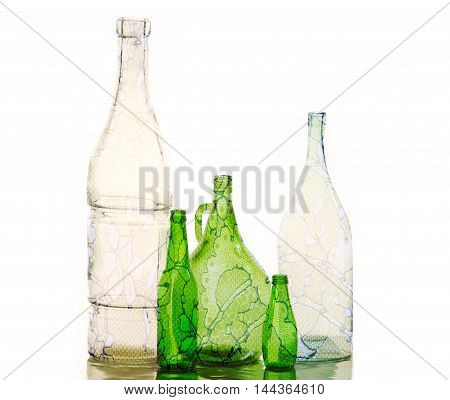 empty bottles. Photo in studio. a container, typically made of glass or plastic and with a narrow neck, used for storing drinks or other liquids.