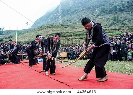 SAPA, VIETNAM, February 12, 2016 Hmong man group, highland Sa Pa, Vietnam, performance, trumpeters, traditional musical instruments, on the occasion of spring