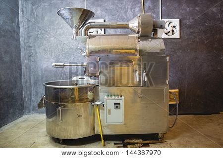 roasted coffee beans silver machine in room