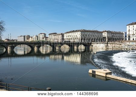 Reflection on Po River in Turin, Italy