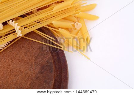 Various types of pasta isolated on white background